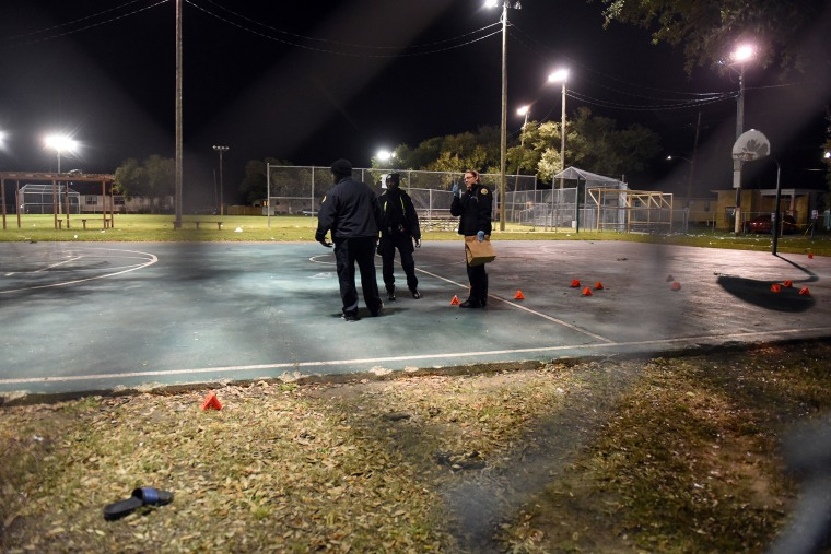 Police gather evidence after a shooting at a playground on Nov. 22, 2015 in New Orleans, La. (Photo by Cheryl Gerber/Getty)