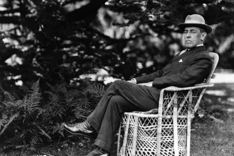 Full length portrait of American President Woodrow Wilson seated outdoors, circa 1920. (Photo by Fotosearch/Getty)