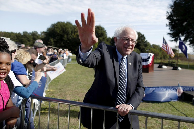 U.S. Democratic presidential candidate Bernie Sanders waves to the crowd after speaking at the Jenkins Institute for Children in North Charleston, S.C., Nov. 21, 2015. (Photo by Randall Hill/Reuters)
