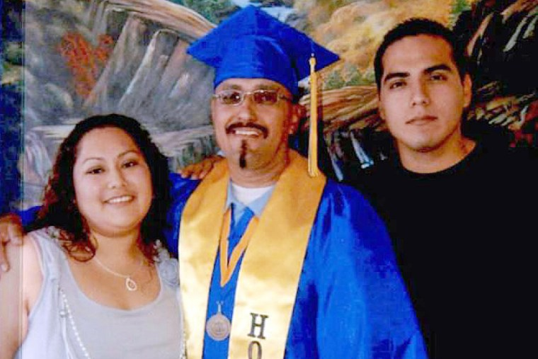 This December, 2013 photo shows Luis Vargas with his daughter and son at his community college graduation ceremony held within the walls of a California state prison in Blythe, Calif. (Photo by California Innocence Project/AP)