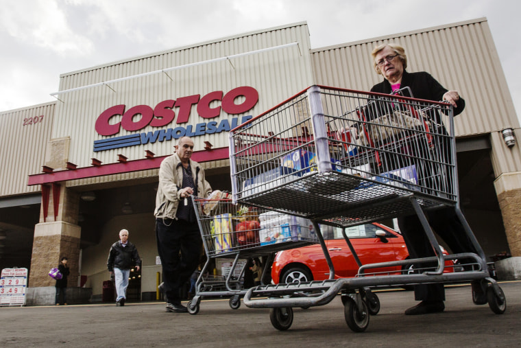 Shoppers leave a Costco store in Alhambra, Calif. on March 3, 2015. (Photo by Ringo Chiu/ZUMA)