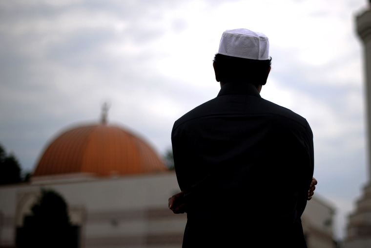 A Muslim takes part in a special morning prayer. (Photo by Jewel Samad/AFP/Getty)
