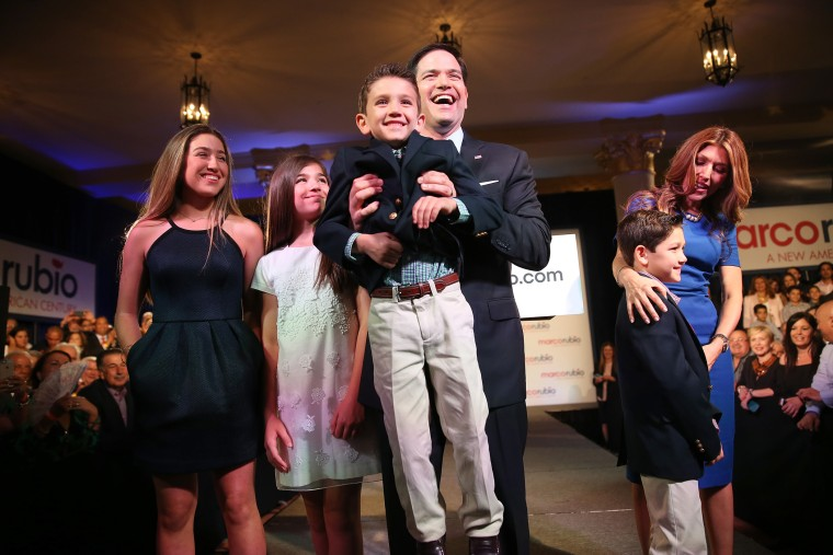 U.S. Sen. Marco Rubio (R-FL) holds his son, Anthony Rubio, as he stands with his family after he announced his candidacy for the Republican presidential nomination during an event at the Freedom Tower, April 13, 2015 in Miami. (Photo by Joe Raedle/Getty)