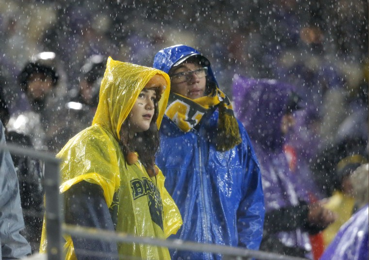 Baylor fans watch the game against TCU in the second half of an NCAA college football game as rain pours down over the stadium, Nov. 27, 2015, Fort Worth, Texas. (Photo by Tony Gutierrez/AP)