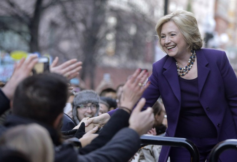 """Democratic presidential candidate Hillary Clinton greets people in a crowd before a rally, """"Hard Hats for Hillary,"""" at Faneuil Hall, Nov. 29, 2015, in Boston. (Photo by Steven Senne/AP)"""