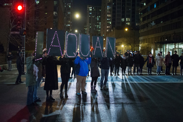 Demonstrators march through downtown following the release of a video showing Chicago Police officer Jason Van Dyke shooting and killing Laquan McDonald on Nov. 24, 2015 in Chicago, Ill. (Photo by Scott Olson/Getty)