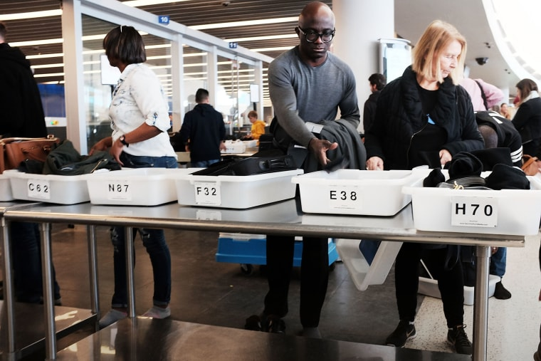 People go through security at JFK Airport, Nov. 25, 2015 in Queens, New York City. (Photo by Spencer Platt/Getty)