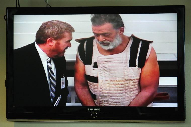 Colorado Springs shooting suspect Robert Dear appears via video before Judge Gilbert Martinez, with public defender Dan King, at the El Paso County Criminal Justice Center, Colo., Nov. 30, 2015. (Photo by Daniel Owen/Pool/AP)