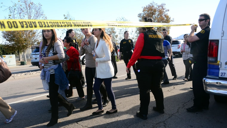 Survivors are evacuated from the scene of a shooting under police and sheriff's escort on Dec. 2, 2015 in San Bernardino, Calif. (Photo by Frederic J. Brown/AFP/Getty)