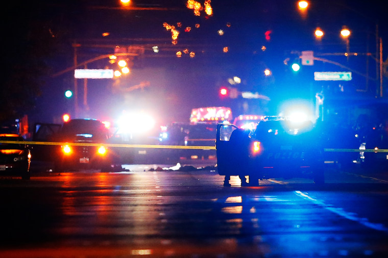 Police vehicles line the street around a vehicle in which two suspects were shot following a mass shooting in San Bernardino, Calif., Dec. 2, 2015. (Photo by Mike Blake/Reuters)
