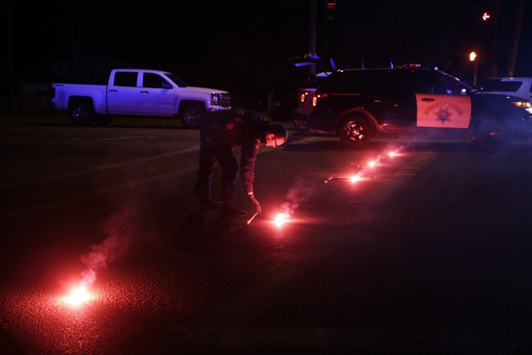 A police officer lights up flares near the scene where a shootout took place, Dec. 2, 2015, in San Bernardino, Calif. (Photo by Jae C. Hong/AP)