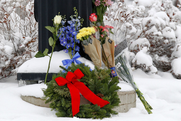 Flowers are left at an intersection near the Planned Parenthood clinic in Colorado Springs, Colo., Nov. 28, 2015. (Photo by Isaiah J. Downing/Reuters)
