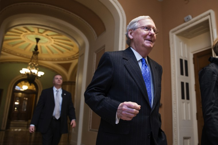 Senate Majority Leader Mitch McConnell, R-Ky., walks from the chamber as Republicans pushed legislation toward Senate approval to defund Planned Parenthood and the ACA, on Capitol Hill in Washington, Dec. 3, 2015. (Photo by J. Scott Applewhite/AP)