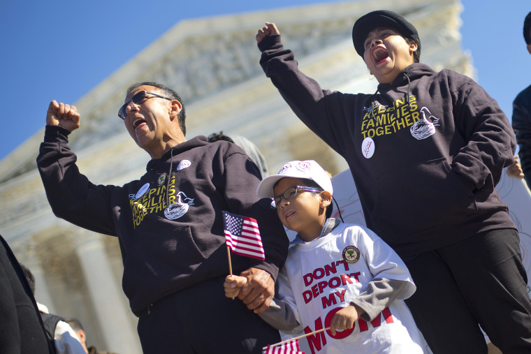 Six-year-old Michael Claros, center, joins his parents during a rally for immigration reform, Nov. 20, 2015, at the Supreme Court in Washington. (Photo by Pablo Martinez Monsivais/AP)