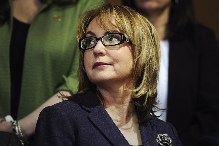 Former Arizona U.S. Rep. Gabby Giffords listens, during a news conference at the state Capitol, March 17, 2015, in Hartford, Conn. (Photo by Jessica Hill/AP)