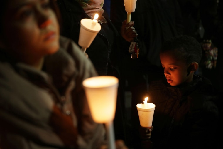 People participate in a candlelight vigil, held by the Council on American-Islamic Relations, for the victims in recent mass shootings Dec. 4, 2015 at the Muslin Community Center in Silver Spring, Md. (Photo by Alex Wong/Getty)
