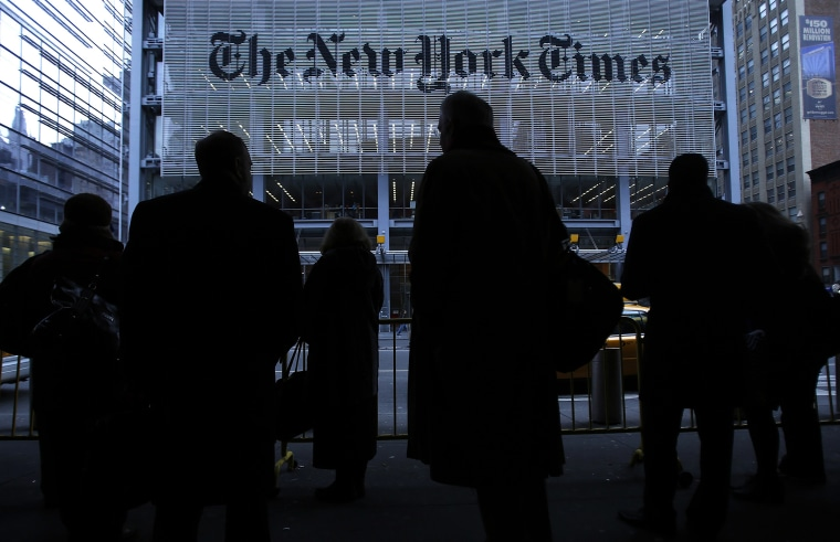People line up for taxi across the street from the New York Times head office in New York, Feb. 7, 2013. (Photo by Carlo Allegri/Reuters)