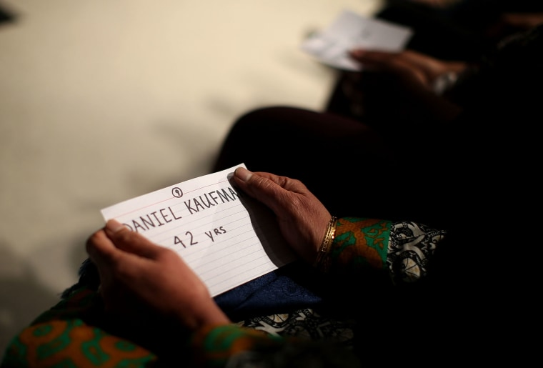 Mourners hold cards with the names of victims of the mass shooting in San Bernardino during a United We Stand vigil at Granada Hills Charter High School on Dec. 5, 2015 in Granada Hills, Calif. (Photo by Justin Sullivan/Getty)