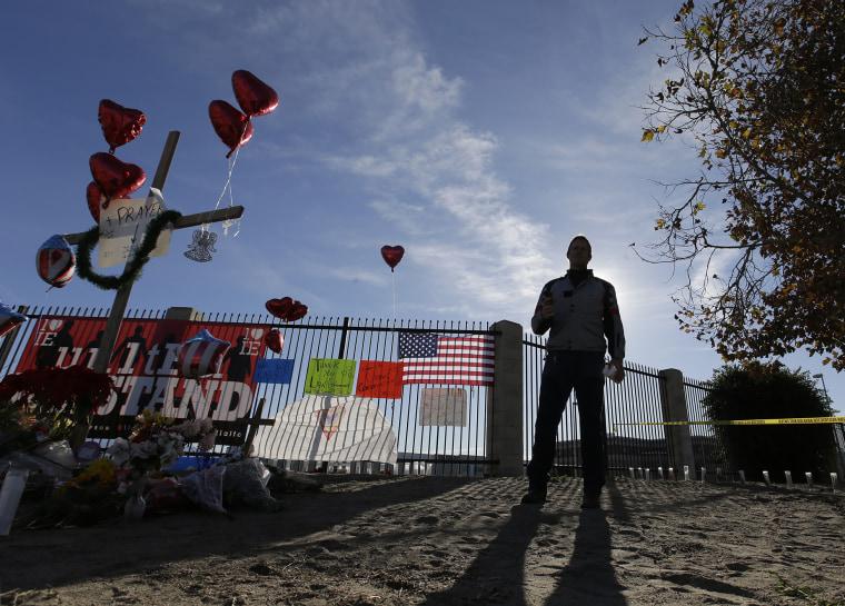 A man pays his respects at a makeshift memorial, Dec. 5, 2015, in San Bernardino, Calif. (Photo by Chris Carlson/AP)