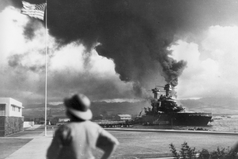 American ships burn during the Japanese attack on Pearl Harbor, Hawaii, on Dec. 7, 1942. (Photo by AP)
