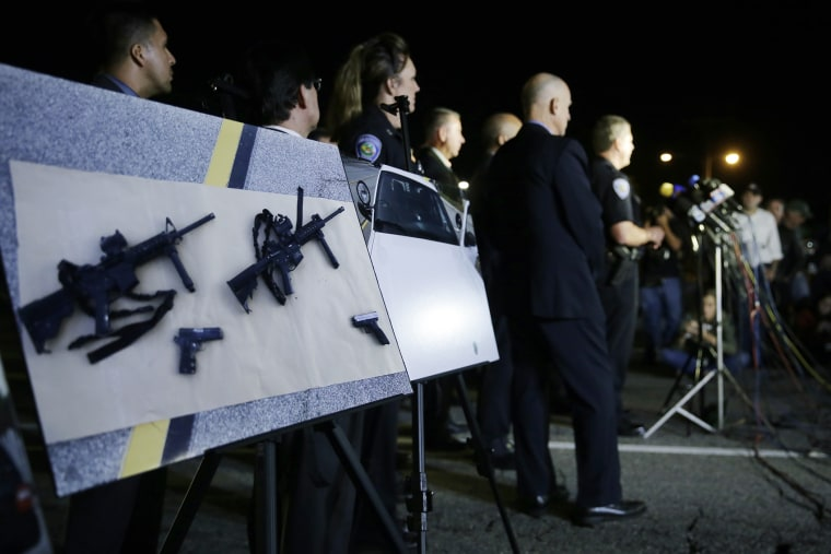 Police crime photos are displayed during a press conference near the site of yesterday's mass shooting on Dec. 3, 2015 in San Bernardino, Calif. (Photo by Chris Carlson/AP)