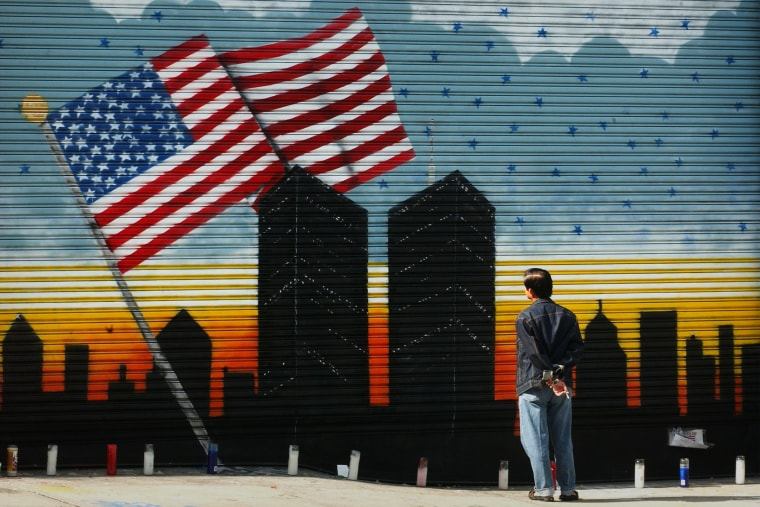 A man pauses to look at a mural in Brooklyn on Sept. 18, 2001 in memory of the World Trade Center and the over 5,000 people who died in the terrorist attack. (Photo by Spencer Platt/Getty)