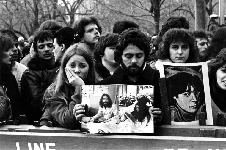 People line up to commemorate John Lennon in Central Park in New York after his death in 1980. (Photo by AGIP/RDA/Getty)