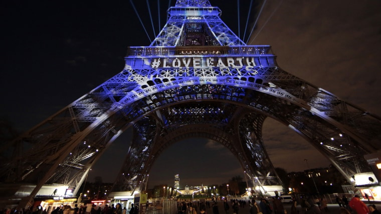 The Eiffel Tower is lit with blue lights as part of the events in the French capital to mark the World Climate Change Conference 2015 (COP21), in Paris, France, Dec. 2, 2015. (Photo by Eric Gaillard/Reuters)