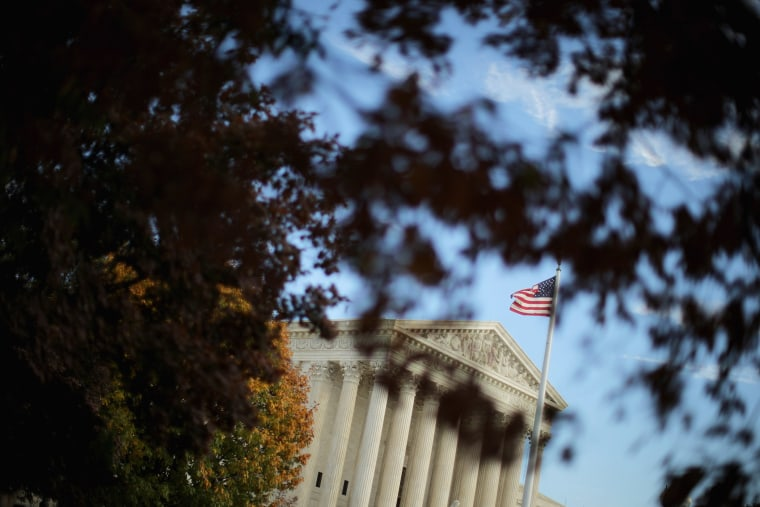 The United States Supreme Court building is framed by fall foliage on Nov. 6, 2015 in Washington, D.C. (Photo by Chip Somodevilla/Getty)