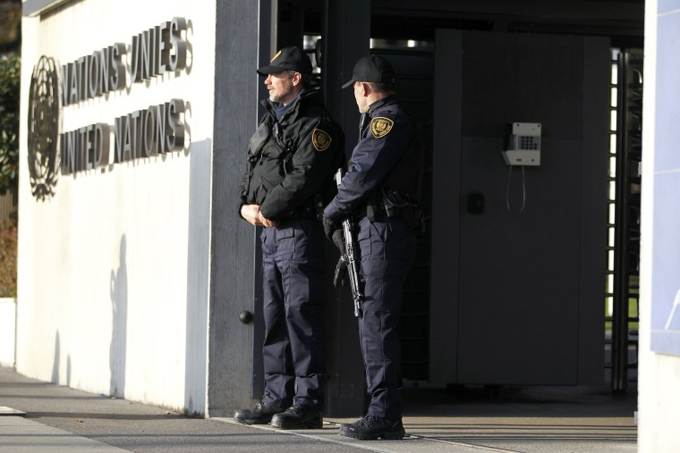 United Nations security officers stand guard outside the U.N. European headquarters in Geneva, Switzerland, Dec. 10, 2015. (Photo by Pierre Albouy/Reuters)