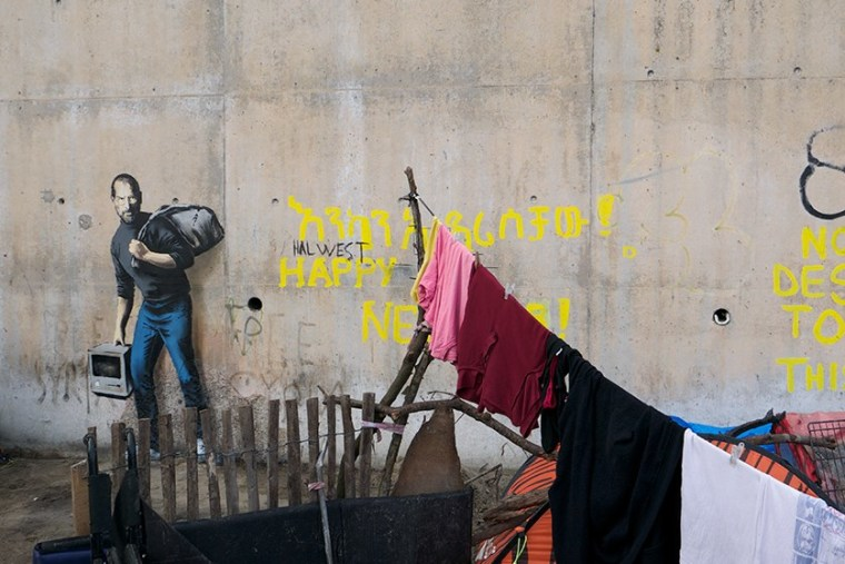 A Banksy mural in a refugee camp in Calais, France, depicts Steve Jobs. (Photo by Banksy)