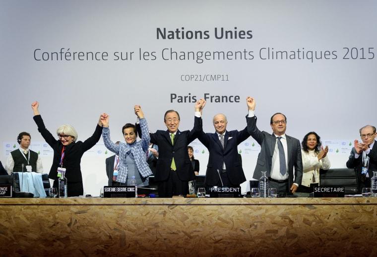 Executive Secretary of the UNFCCC Christiana Figueres, UN Secretary General Ban Ki Moon, President-designate of COP21 Laurent Fabius, and France's President Francois Hollande, Dec. 12, 2015. (Photo by Arnaud BOUISSOU/COP21/Anadolu Agency/Getty)