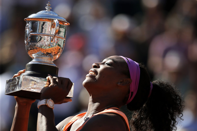 Serena Williams of the U.S holds the cup after defeating Lucie Safarova of the Czech Republic during their final match of the French Open tennis tournament at the Roland Garros stadium, June 6, 2015 in Paris. (Photo by Francois Mori/AP)