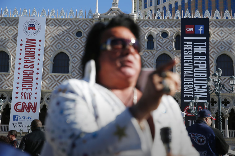 An Elvis impersonator performs outside the Venetian Hotel & Casino before the CNN Republican presidential debate on Dec. 15, 2015, in Las Vegas. (Photo by John Locher/AP)