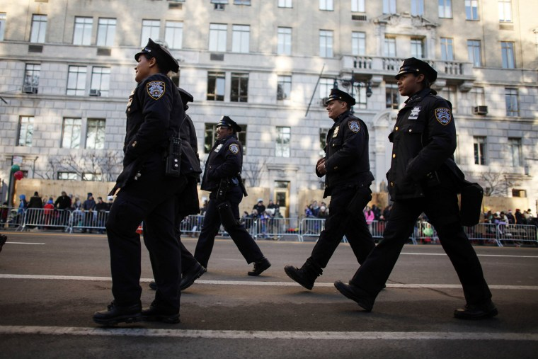 Members of the New York City Police department walk on Central Park West before the annual Thanksgiving Day Parade on Nov. 26, 2015 in New York City. (Photo by Kena Betancur/Getty)