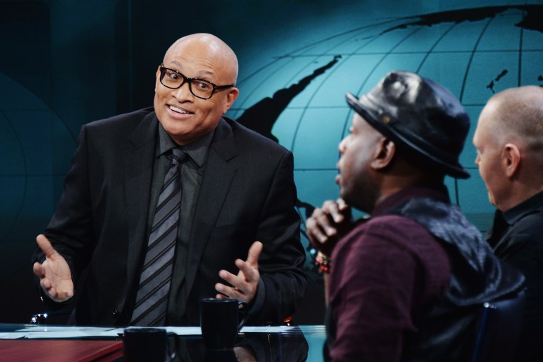 """Larry Wilmore jokes with hip-hop artist/activist Talib Kweli and comedian Bill Burr on the debut episode of Comedy Central's """"The Nightly Show with Larry Wilmore"""" on Jan. 19, 2015 in New York City. (Photo by Stephen Lovekin/Comedy Central/Getty)"""