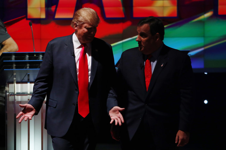 Republican U.S. presidential candidates Donald Trump and Chris Christie talk during a commercial break of the Republican presidential debate in Las Vegas, Nev., Dec. 15, 2015. (Photo by Mike Blake/Reuters)