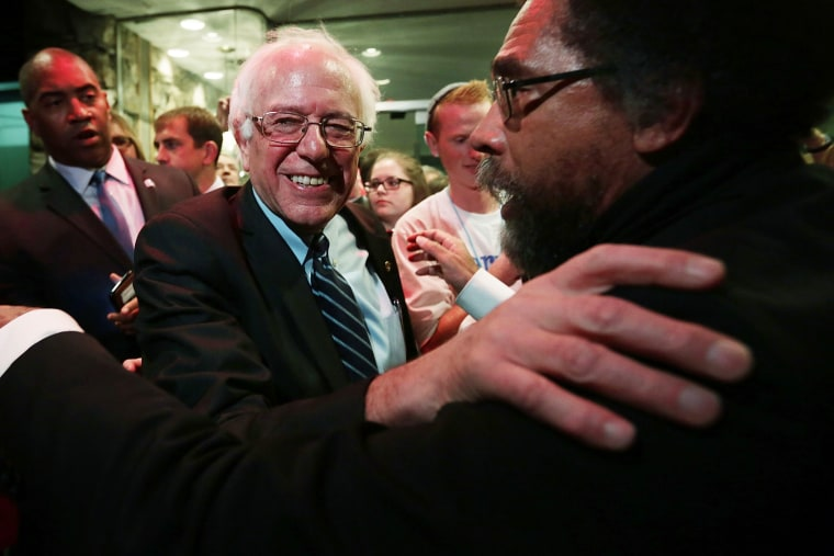 Democratic presidential candidate Sen. Bernie Sanders (I-VT) and philosopher Cornel West (R) embrace at a watch party for the second Democratic presidential debate Nov. 14, 2015 in Des Moines, Iowa. (Photo by Alex Wong/Getty)