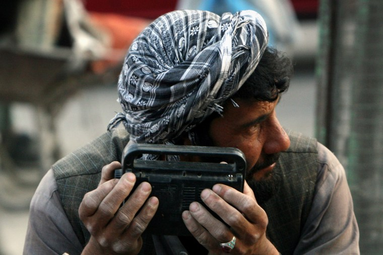 An Afghan man searches the waves of a radio to hear the tim efor breaking his daily ramadan fast in the city of Kabul, Afghanistan, Sep. 24, 2007. (Photo by Musadeq Sadeq/AP)