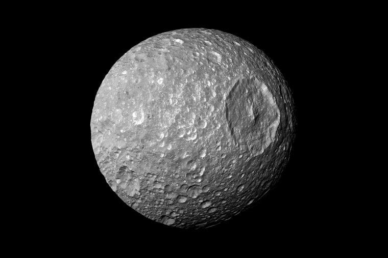 """In this view captured by NASA's Cassini spacecraft on its closest-ever flyby of Saturn's moon Mimas, large Herschel Crater dominates Mimas, making the moon look like the Death Star in the movie """"Star Wars."""""""