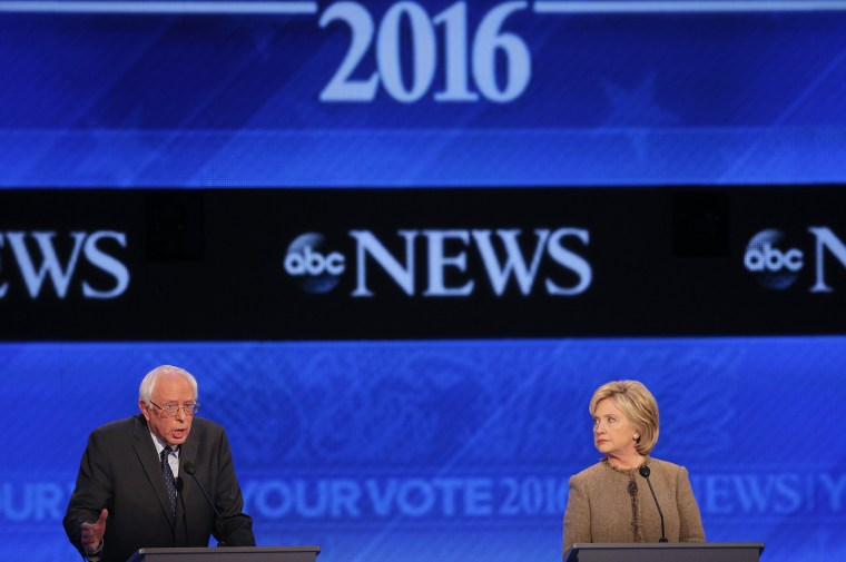 Democratic presidential candidate Hillary Clinton listens as Senator Bernie Sanders defends his positions and votes on gun control at the presidential debate at St. Anselm College in Manchester, N.H. Dec. 19, 2015. (Photo by Brian Snyder/Reuters)