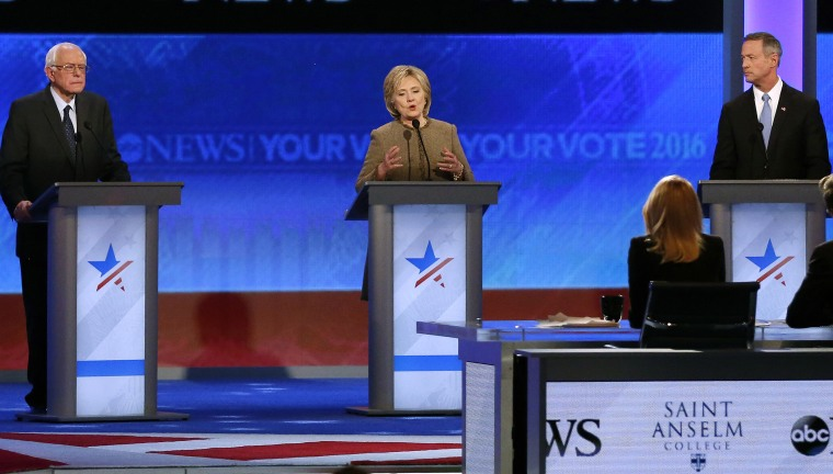 Hillary Clinton, center, speaks between Bernie Sanders and Martin O'Malley during a Democratic presidential primary debate, Dec. 19, 2015, at Saint Anselm College in Manchester, N.H. (Photo by Jim Cole/AP)