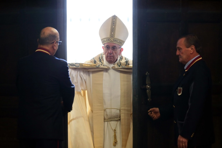 Pope Francis opens the Holy Door of St. Peter's Basilica on Dec. 8, 2015 in Vatican City, Vatican. (Photo by Vatican Pool/Getty)