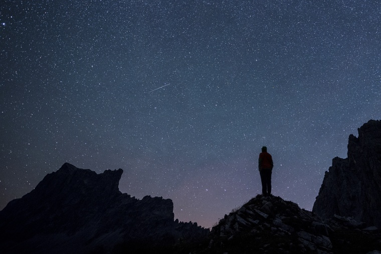 Stars and shooting stars are pictured during the annual Perseids meteor shower, with the 2827-meters Drusenfluh mountain (L) and the 2817-meters Sulzfluh mountain (R), in St. Antoenien in the canton of Grisons, Switzerland, on Aug. 13, 2015.