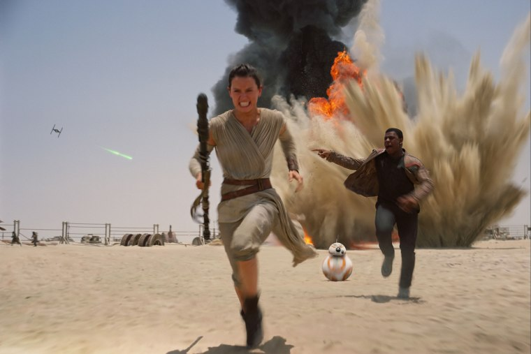 """This photo provided by Disney shows Daisy Ridley as Rey, left, and John Boyega as Finn, in a scene from the new film, """"Star Wars: The Force Awakens."""" (Photo by Film Frame/Disney/Lucasfilm/AP)"""