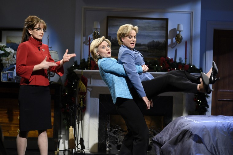"(L-R) Tina Fey as Sarah Palin, Kate McKinnon as Hillary Clinton, and Amy Poehler as Hillary Clinton during the ""A Hillary Christmas"" sketch on Dec. 19, 2015. (Photo by Dana Edelson/NBC/NBCU Photo Bank/Getty)"