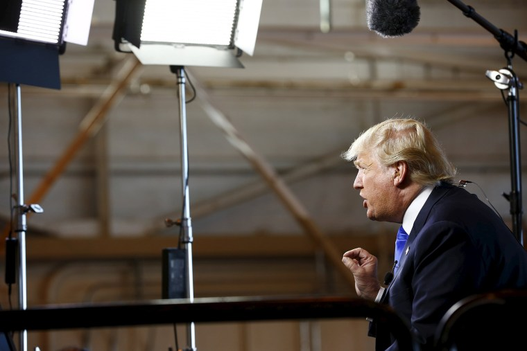 Republican presidential candidate Donald Trump gives an interview to Bill O'Reilly of Fox News before speaking at a campaign rally in Mesa, Ariz., Dec. 16, 2015. (Photo by Nancy Weichec/Reuters)