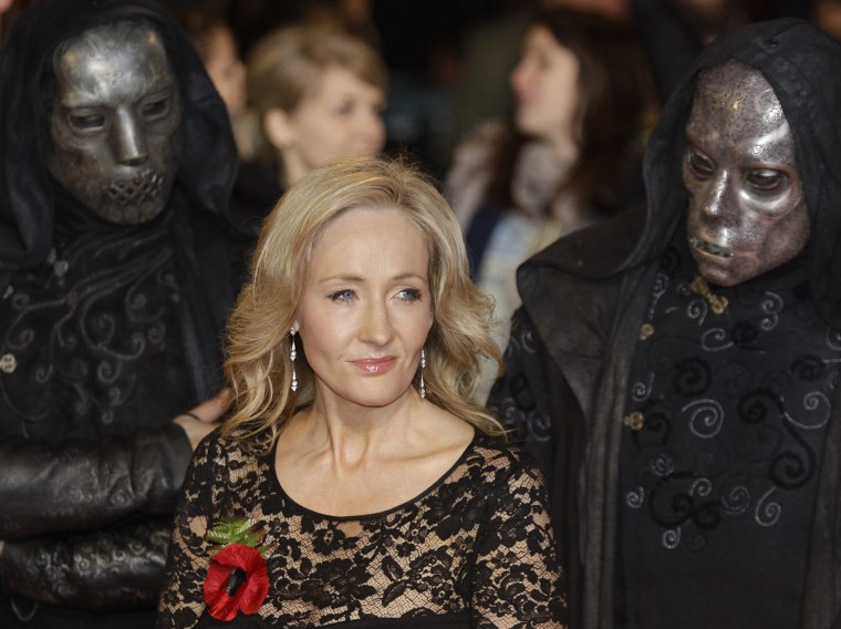 British author JK Rowling poses for the photographers as she attends the world premiere of the latest film' Harry Potter and The Deathly Hallows', at a cinema in central London, Nov. 11, 2010. (Photo by Lefteris Pitarakis/AP)