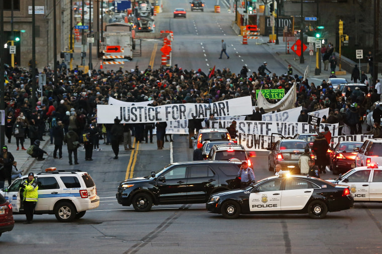 Hundreds of Black Lives Matter demonstrators and supporters occupy the street in front of the federal building, Nov. 24, 2015, in Minneapolis, after marching from the Police Department's Fourth Precinct. (Photo by Jim Mone/AP)