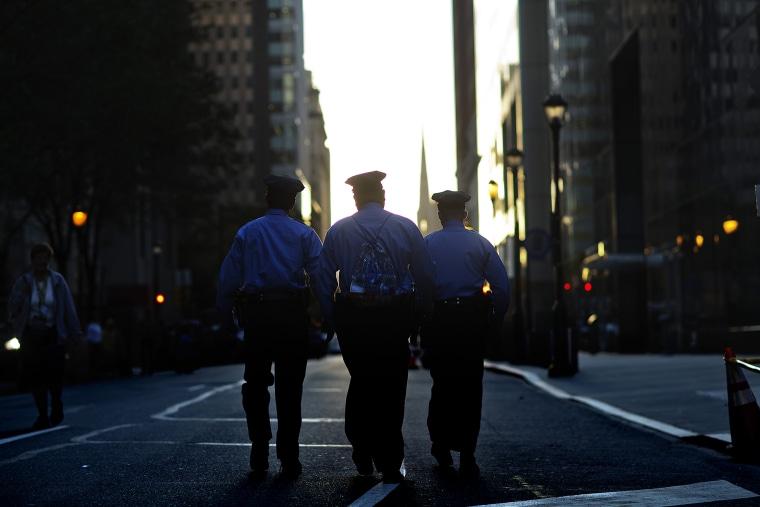Police walk along Arch Street, Sept. 27, 2015, in Philadelphia, Pa. (Photo by David Goldman/AP)